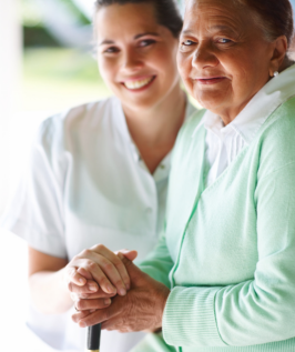 caregiver holding the hands of patient